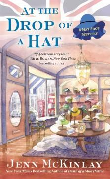 'At the Drop of a Hat (A Hat Shop Mystery, #3)' by Jenn McKinlay