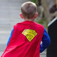 child in superhero cape