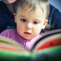 parent and toddler reading